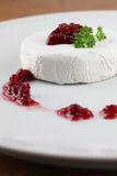 Camembert with cranberry jam Royalty Free Stock Photo