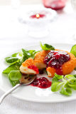 Camembert with cranberry sauce Stock Images
