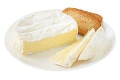 Camembert de fromage avec des pains grillés image stock