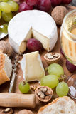 Camembert, glass of white wine, grapes and fresh baguette Royalty Free Stock Photography