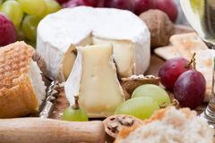 Camembert, grapes and fresh baguette, close-up Royalty Free Stock Photos