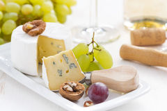 Camembert with Grapes and white wine Royalty Free Stock Image