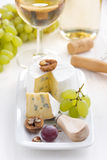 Camembert with Grapes and white wine, vertical Royalty Free Stock Photos