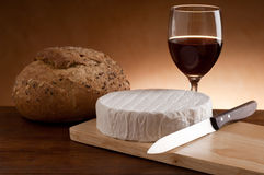 camembert with knife and bread Stock Photography