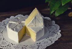 Camembert with noble white mold. Exquisite cheese. Camembert cheese on a rustic background.French cheese with a white mold. Brie cheese with white noble mould Stock Photo