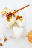 Camembert with nuts and honey Royalty Free Stock Photography