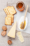 Camembert and parmesan cheese, honey and nuts Royalty Free Stock Photo