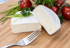 Camembert pieces on cutting board Stock Images