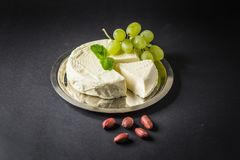 Camembert on the Plate with Grape, Peanuts and Mint.  Stock Photo