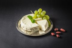 Camembert on the Plate with Grape, Peanuts and Mint.  Stock Photography