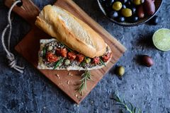 Camembert spread with tapenade and sun dried tomato. Baguette with Camembert spread, tapenade and sun dried tomato Royalty Free Stock Photos