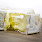 Camembert. On wooden table close up Royalty Free Stock Photo