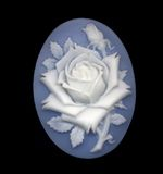 Cameo. A blue and white cameo featuring a rose Stock Image