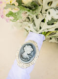 Cameo on bridal bouquet. Gray cameo on bridal bouquet royalty free stock image