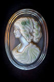 Cameo with a girls face is mother of pearl. Royalty Free Stock Images