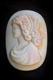 Cameo with a girls face is mother of pearl. Royalty Free Stock Image