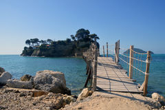 Cameo island. A little island Agios Sostis /Cameo island/ near Zakynthos which is coming close makeshift bridge on which two people can hardly pass each other stock images
