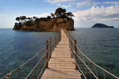 Cameo island. A little island Agios Sostis /Cameo island/ near Zakynthos which is coming close makeshift bridge on which two people can hardly pass each other royalty free stock image