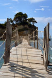 Cameo island. A little island Agios Sostis /Cameo island/ near Zakynthos which is coming close makeshift bridge on which two people can hardly pass each other royalty free stock photography