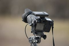 Camera. Slr camera on a tripod out in the fields Royalty Free Stock Images