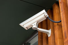 Camera. A video surveillance camera on a wall Stock Photo