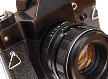 Camera. Old black camera with an objective Royalty Free Stock Photography