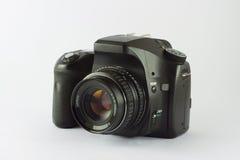 Camera. Black photo camera isolated in white royalty free stock photo