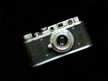 Camera. Retro camera on the black background Stock Photography