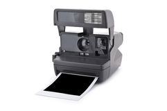 Camera. Vintage instant film camera with blank instant photo Isolated on a white background Royalty Free Stock Photos