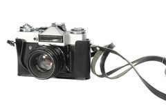 Camera. Old SLR camera shot isolated on a white background Royalty Free Stock Photos