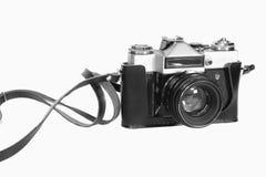 Camera. Old SLR camera shot isolated on a white background Stock Photo