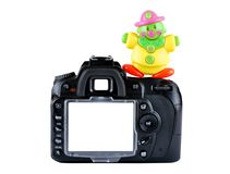 Camera. Image of digital camera with a toy Stock Photos