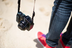 Camera. A person with a camera on the beach Royalty Free Stock Photography