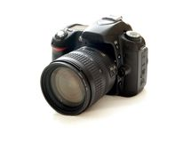 Camera. A digital camera S L R with zoom Royalty Free Stock Photos