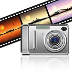 Camera. On strip film background Royalty Free Stock Photos