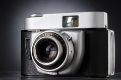 Camera. A vintage 35mm camera against dark background - focus on f-numbers Stock Images