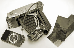 Camera. The old film camera with exposure measuring instrument and negatives royalty free stock image
