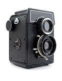 The camera. The beautiful ancient black camera on a white background Royalty Free Stock Images
