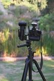 Camera. Setting up the camera on a tripod Royalty Free Stock Photo
