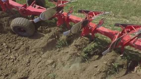 Plowing. The camera is accompanied by a tractor, which plows the ground with a plow stock video