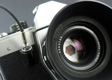 Camera in action. Camera taking picture. Represent camera aperture in action during the moment of taking picture Royalty Free Stock Photo