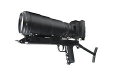 The camera is actually held in the same manner as a rifle. On white background Royalty Free Stock Images