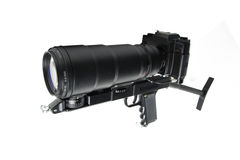 The camera is actually held in the same manner as a rifle. On white background Stock Photos
