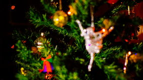 Camera adjusts the focus and is fixed to the christmas figure in the form of a ballerina. stock footage