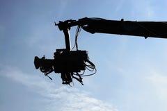 Camera against blue sky. Professional Tv camera against blue sky Royalty Free Stock Photos