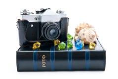 Camera and album Stock Image