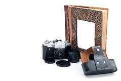 Camera and album Royalty Free Stock Photos
