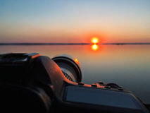 Camera on background of a beautiful sunset. take a photo by came Royalty Free Stock Photo