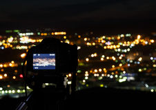 The camera on the background of the city at night Stock Photography