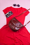 Camera, bag, dress and sunglasses Royalty Free Stock Photography
